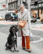 coat,faux fur coat,brown shoes,wide-leg pants,crossbody bag,white sweater,turtleneck sweater