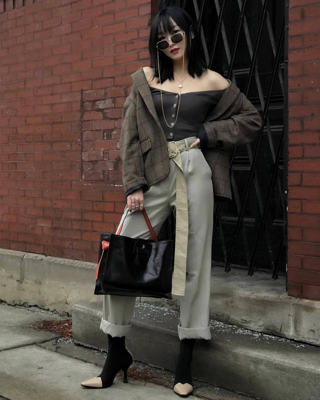 top grey top long sleeves high waisted pants pleated black boots celine black bag plaid blazer