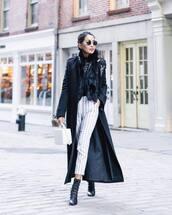 pants,striped pants,white pants,neutral high waisted pants,black boots,ankle boots,long coat,black coat,white bag,boxed bag,faux fur vest,black t-shirt