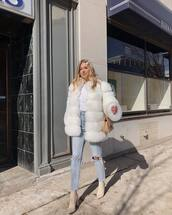 coat,faux fur coat,white coat,high waisted jeans,cropped jeans,ripped jeans,sock boots,bag,white t-shirt