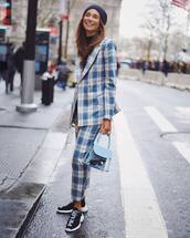 jacket,blazer,plaid,straight pants,black sneakers,blue bag,handbag,pvc,black turtleneck top,beanie