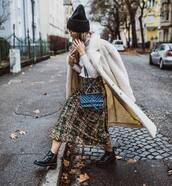 bag,crossbody bag,black boots,ankle boots,plaid skirt,midi skirt,white coat,faux fur,white top,turtleneck,blue bag,hat,knit