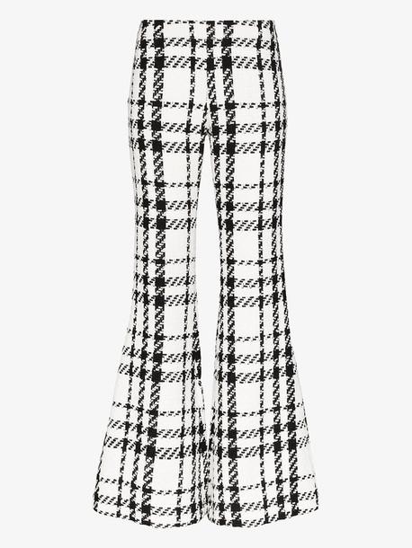 Balmain check tweed flared trousers in black
