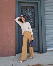 sweater,open back,vince,wide-leg pants,high waisted pants,white sandals,handbag