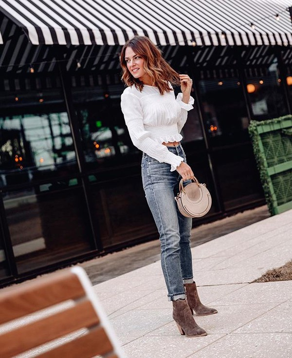 top white top long sleeves crop tops high waisted jeans skinny jeans ankle boots brown boots handbag