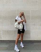 bag,handbag,sneakers,black shorts,crop tops,sweatshirt