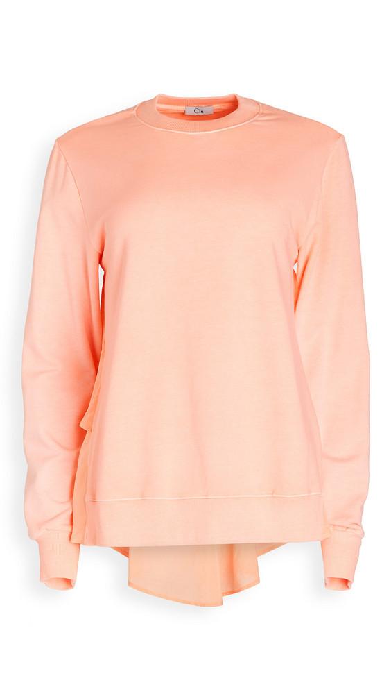 Clu Ruffled Back Pullover in cream / orange