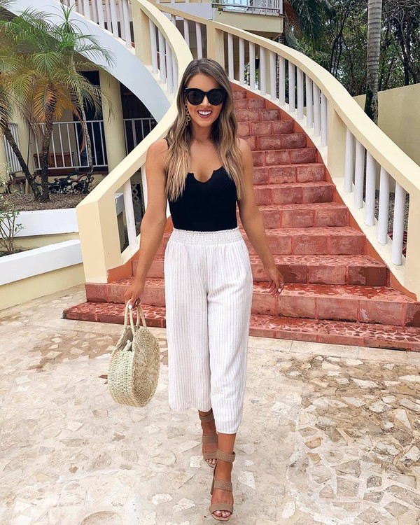 pants white pants stripes high waisted pants sandals bag black top black sunglasses