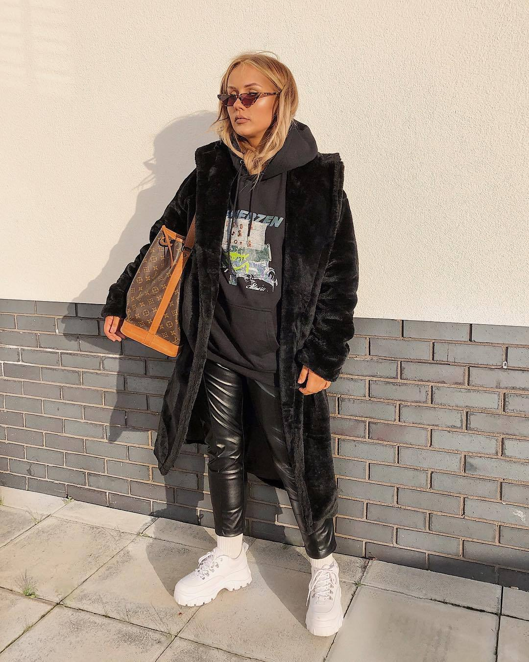 coat faux fur coat black coat white shoes platform shoes leather pants louis vuitton bag black hoodie pretty little thing