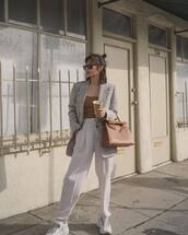 pants,high waisted pants,pleated,white pants,white sneakers,brown bag,plaid blazer,top