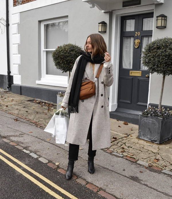 coat long coat double breasted black boots black pants brown bag scarf white sweater