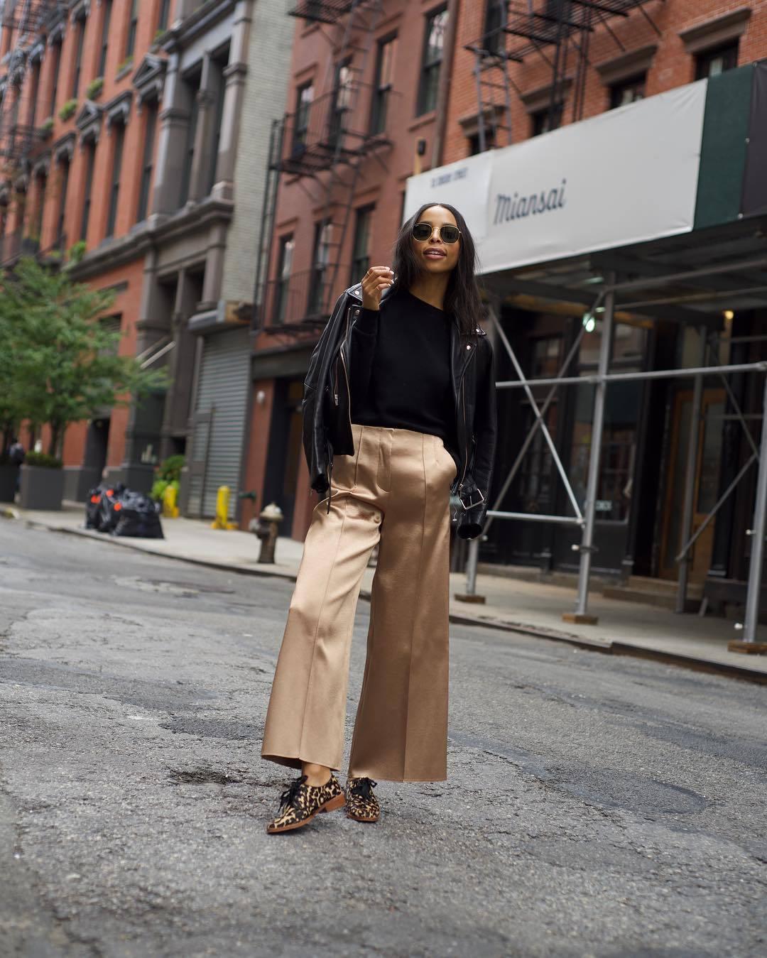 pants gold pants wide-leg pants high waisted leopard print shoes black jacket leather jacket black sweater