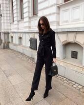jumpsuit,black jumpsuit,long sleeves,black boots,sock boots,black bag,handbag