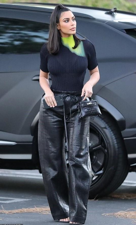 top black black top kim kardashian kardashians pants celebrity leather leather pants