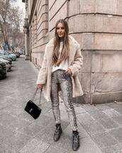 pants,skinny pants,snake print,black boots,ankle boots,ysl bag,black bag,teddy bear coat,white top