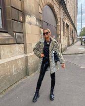 coat,faux fur coat,leopard print,black boots,vinyl,pants,black t-shirt,black bag