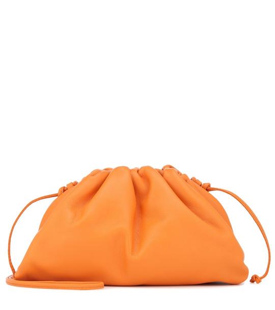 Bottega Veneta The Pouch 20 leather clutch in orange