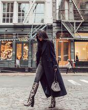 coat,black coat,long coat,snake print,knee high boots,heel boots,grey jeans,skinny jeans,crossbody bag,black turtleneck top