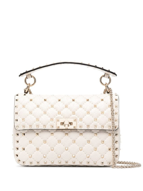 Valentino Garavani Rockstud envelope crossbody bag in neutrals