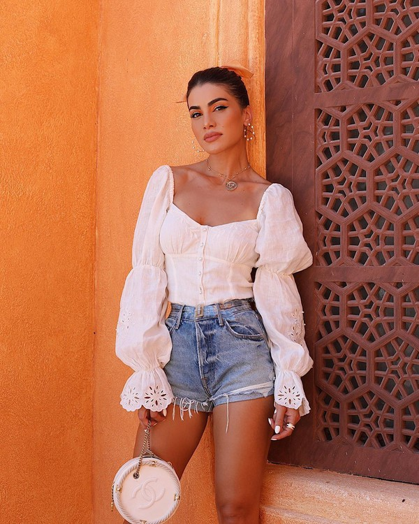 top white top long sleeves lace top denim shorts High waisted shorts white bag chanel bag