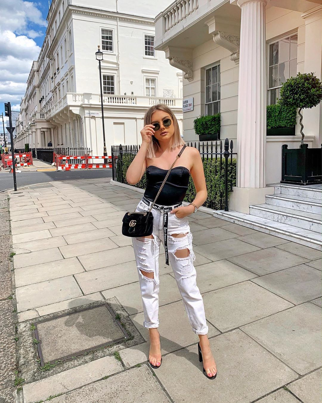 jeans white jeans ripped jeans high waisted jeans black top corset sandal heels gucci bag