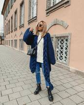 coat,navy coat,black boots,DrMartens,ripped jeans,white sweater,cable knit,turtleneck sweater,crossbody bag,sweater,cropped jeans,black bag