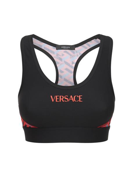 VERSACE Tech Jersey Logo Bra Top in black / multi