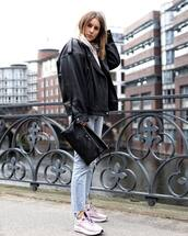 jacket,black leather jacket,sneakers,cropped jeans,ripped jeans,black bag,white hoodie