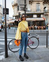 jeans,cropped jeans,black boots,crop tops,long sleeves,orange bag