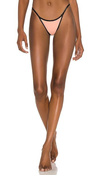 KORAL Kyra Reversible Blackout Bikini Bottom in Black,Coral