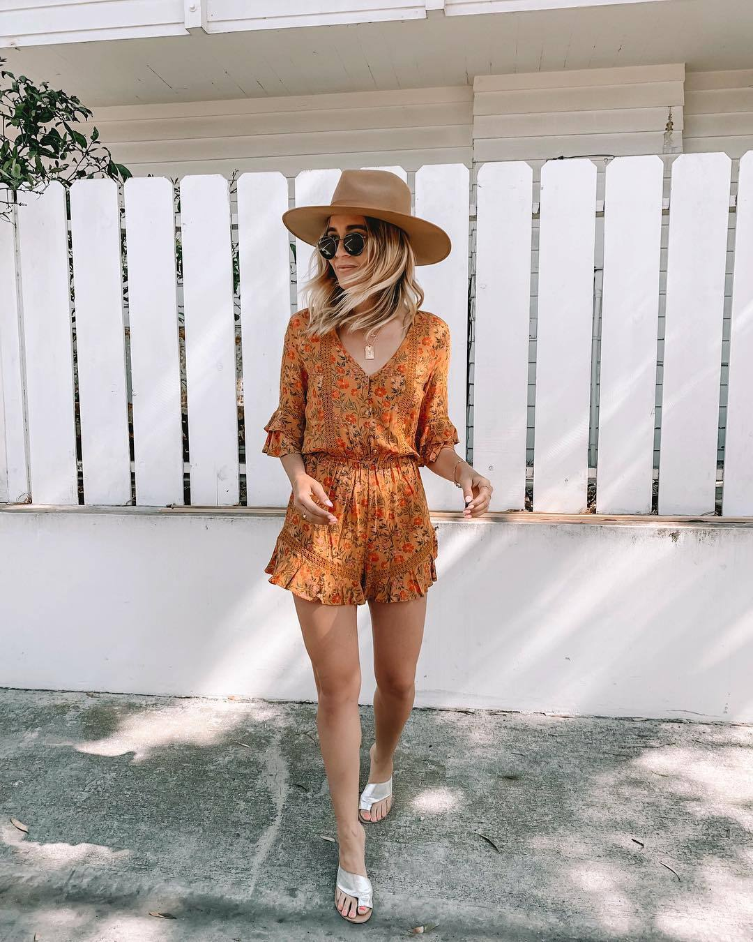 romper floral sandals summer outfits sunglasses hat