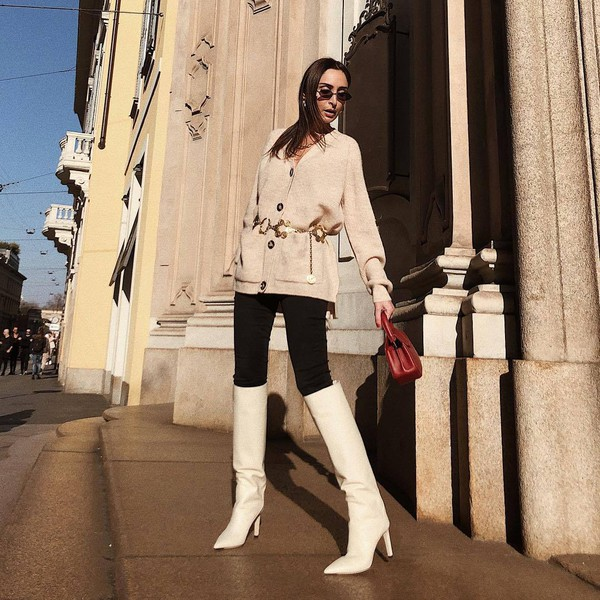 sweater knitted cardigan acne studios knee high boots white boots heel boots black skinny jeans handbag belt sunglasses