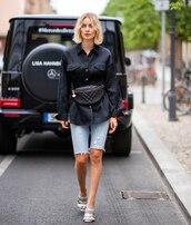 hat,shirt,black shirt,belt bag,denim shorts,shoes,streetstyle