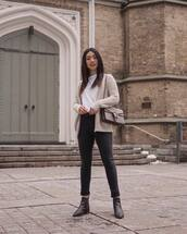 jeans,black jeans,black skinny jeans,black boots,ankle boots,gucci bag,cardigan,white t-shirt