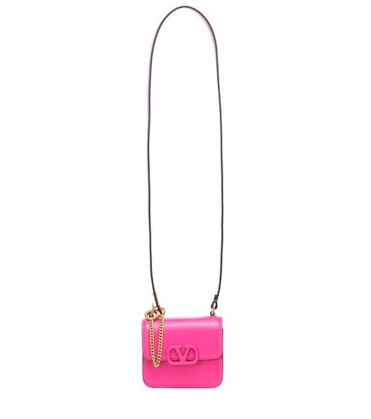 Valentino Garavani VSLING Mini leather shoulder bag in pink