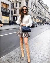 sweater,white sweater,knee high boots,heel boots,mini skirt,snake print,black bag,chanel bag