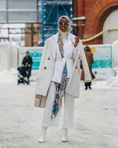 coat,double breasted,beige coat,white boots,knee high boots,wide-leg pants,capri pants,white pants,white blazer,handbag,scarf,white turtleneck top