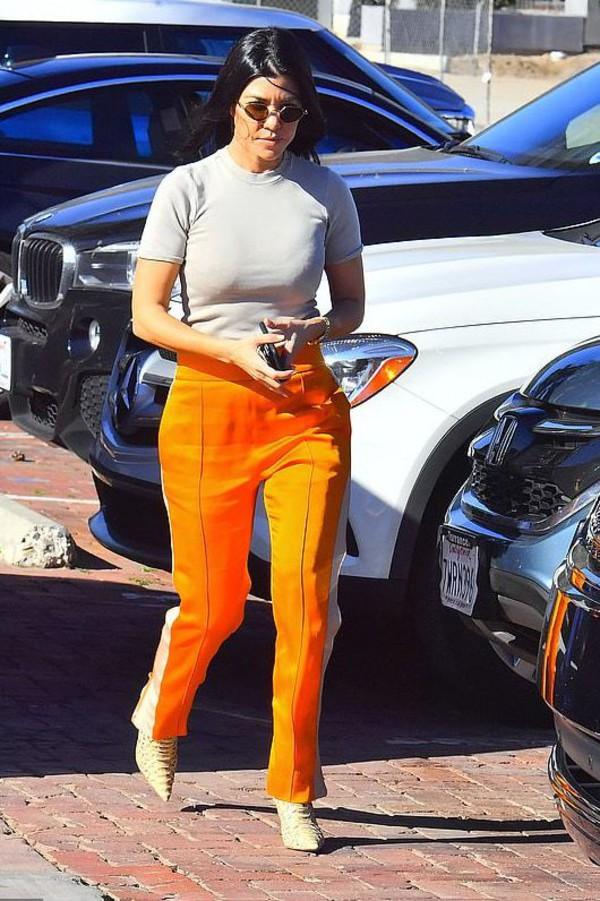 pants white white top orange kourtney kardashian kardashians celebrity