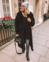 coat,teddy bear coat,black coat,oversized coat,black boots,black bag,crossbody bag,grey jeans,ripped jeans,black sweater,chunky knit,grey beanie