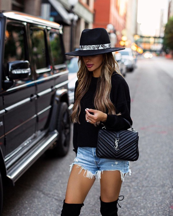 shorts denim shorts black sweater over the knee boots black boots black bag ysl bag hat