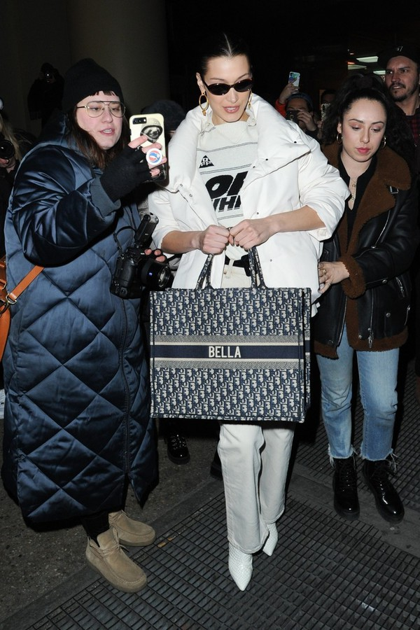 bag bella hadid gigi hadid model model off-duty fw 2019 white coat off-white dior damsel in dior
