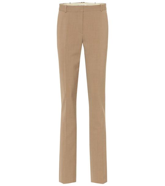 The Row Roosevelt mid-rise skinny wool pants in beige