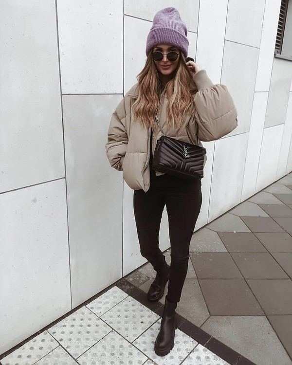 jeans black skinny jeans black boots ankle boots puffer jacket beanie ysl bag