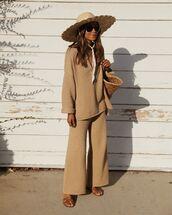 pants,knitwear,wide-leg pants,sweater,slide shoes,bag,hat