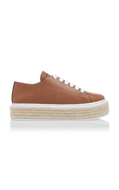 Prada Leather Sneakers in brown