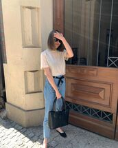 top,cropped t-shirt,high waisted jeans,mules,black bag