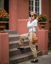 pants,wide-leg pants,pleated,black loafers,brown bag,white shirt,beret