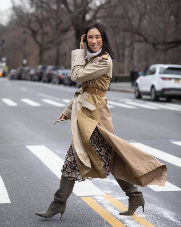 coat trench coat asymmetrical knee high boots snake print midi skirt white sweater turtleneck sweater