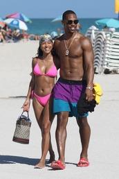 swimwear,karrueche,pink swimwear,pink,bikini,bikini top,bikini bottoms,beach