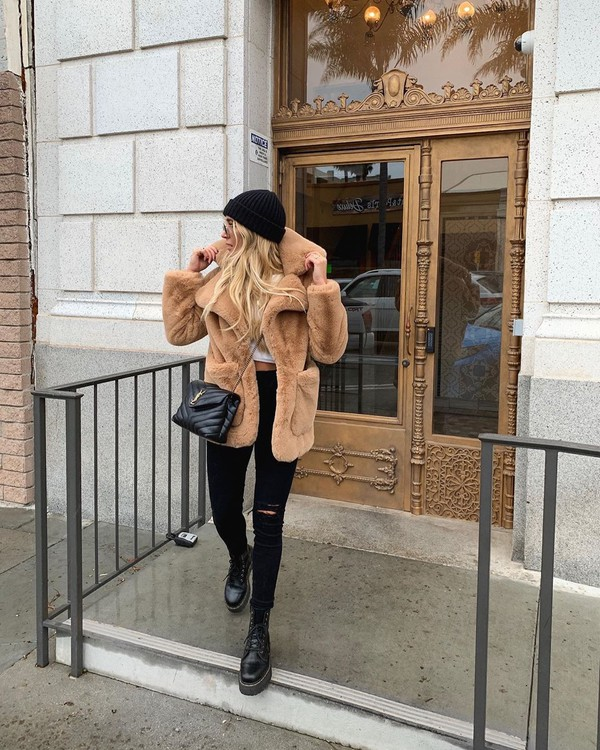 jacket faux fur jacket black boots black ripped jeans black bag white top beanie